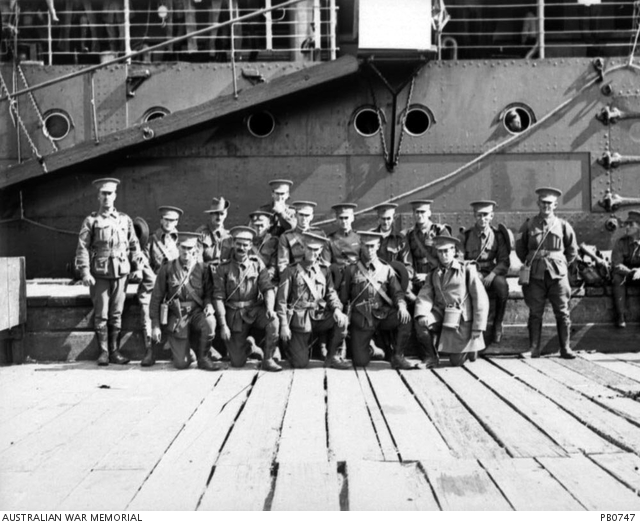 Members of either No 1 or No 2 Squadrons Australian Flying Corps (AFC) grouped in front of troopship HMAT Orsova (A67), 1916. (source AWM)