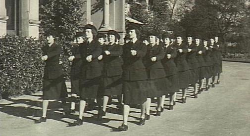 Melbourne, Vic. C. 1942. A flight of WAAAF airwomen marching off from parade at No. 1 WAAAF