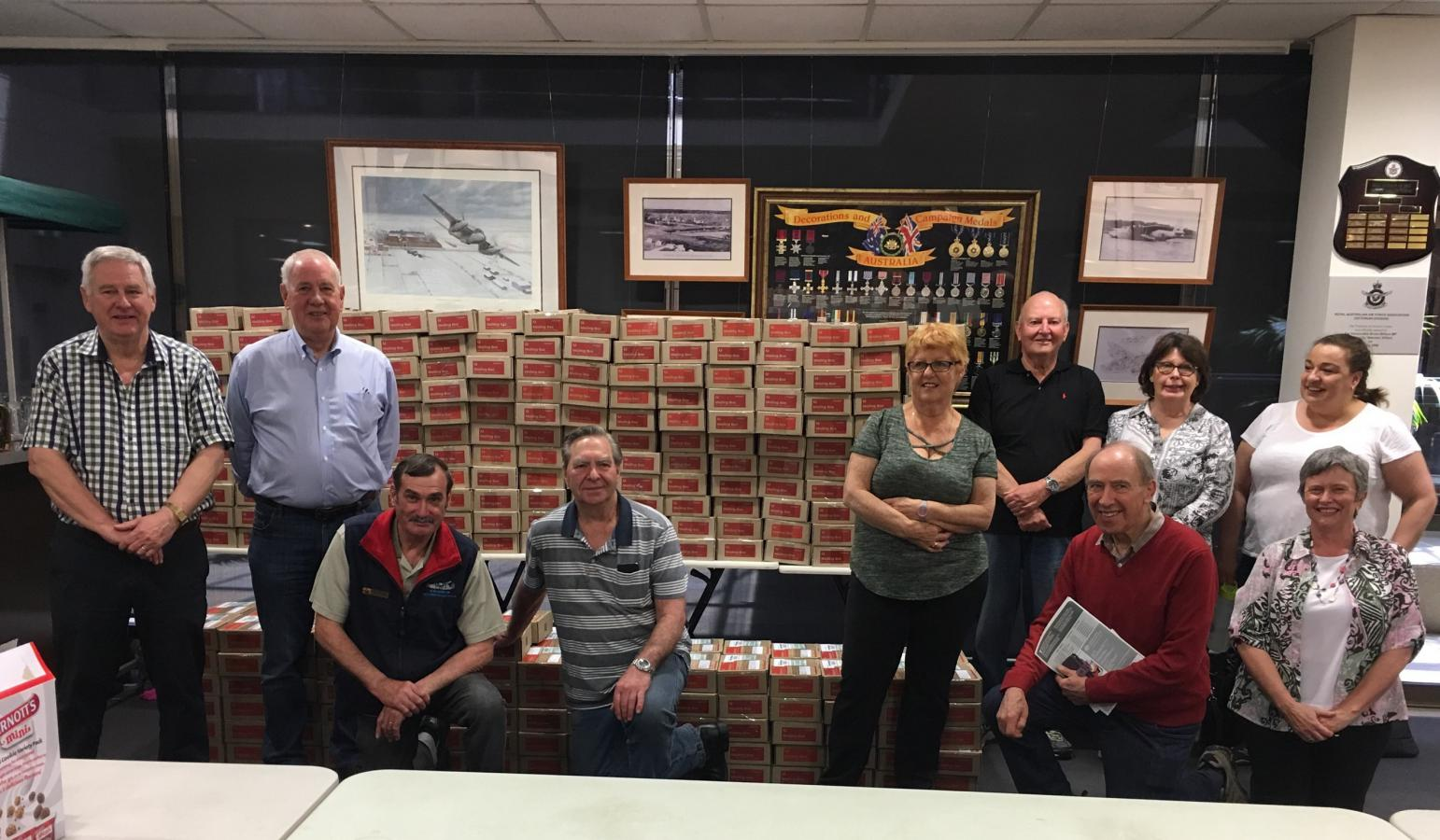 Care Parcel volunteers (L toR): John McCrystal, Max McGregor, Paul Rourke, Bruce Lovett, Di Hoopert, Peter Wilson (Back) Cheryl McCrystal (Back), Carol (Back), Chris Hudnott (Front), Barb Stallard (Office) (Front)
